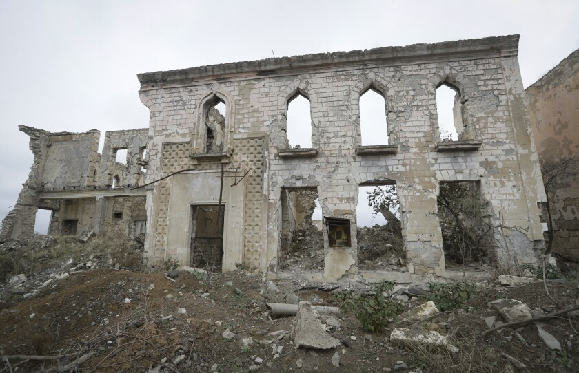 Ruined buildings in Aghdam, which Armenian-backed forces have handed back to Azerbaijan