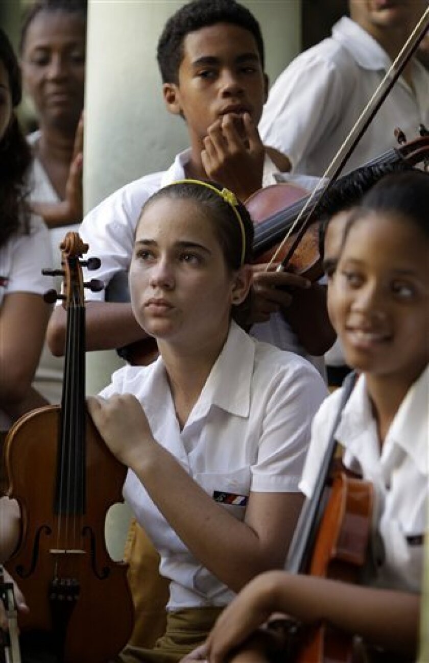 Students meet with members of the Jazz at Lincoln Center at the Conservatory School Guillermo Tomas in Havana, Cuba, Wednesday, Sept. 7, 2011. Jazz at Lincoln Center returned to the Caribbean island with instruments to be donated to four designated music schools and a group of talented musicians and luthiers who will impart workshops to students and also repair their damaged instruments on a week-long visit. (AP Photo/Javier Galeano)
