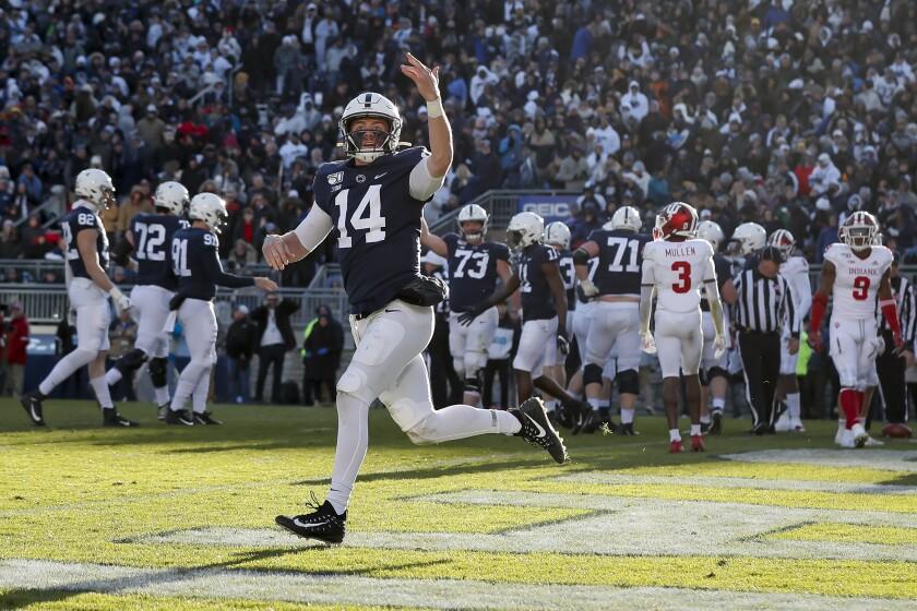 Penn State quarterback Sean Clifford celebrates after scoring a touchdown against Indiana.