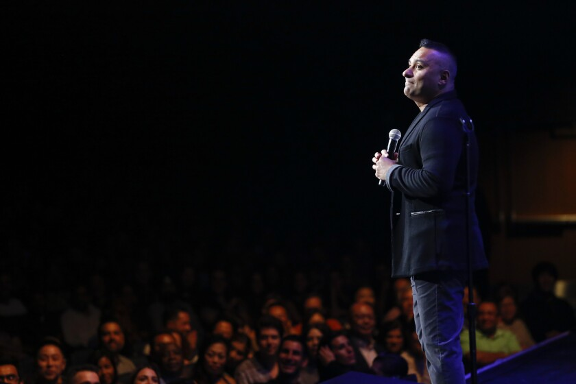 Russell Peters jokes with a crowd at the sold-out Nokia, part of his Almost Famous comedy tour.