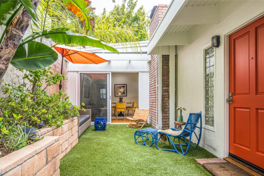 The cozy two-bedroom expands to a spacious deck overlooking L.A.
