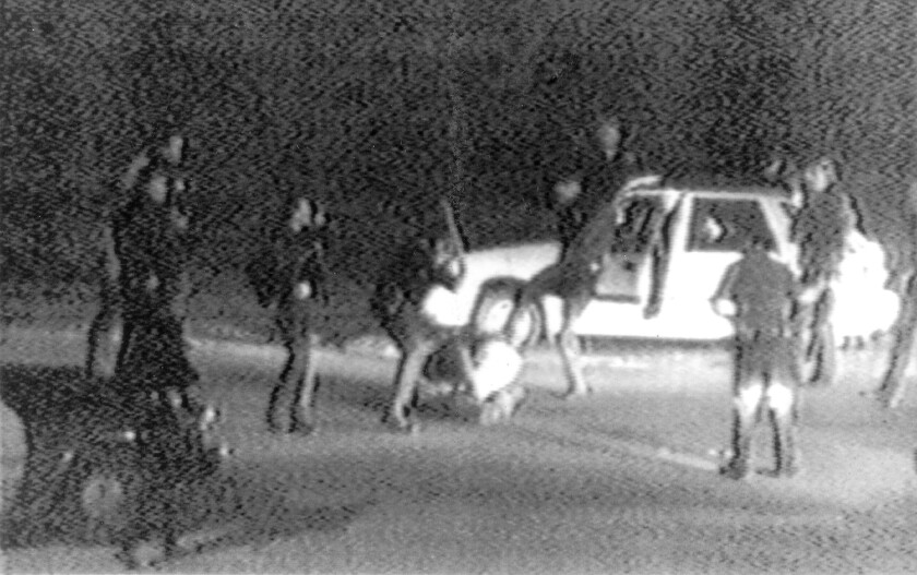 An image from a video shows L.A. police officers beating Rodney G. King. Police delivered 56 blows to King during the 1991 altercation that marked the beginning of the end of the baton's reign.