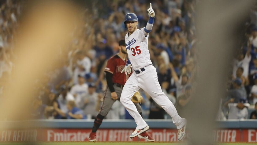 LOS ANGELES, CALIF. - JULY 3, 2019. Dodgers right fielder Cody Bellinger rounds the bases after hit