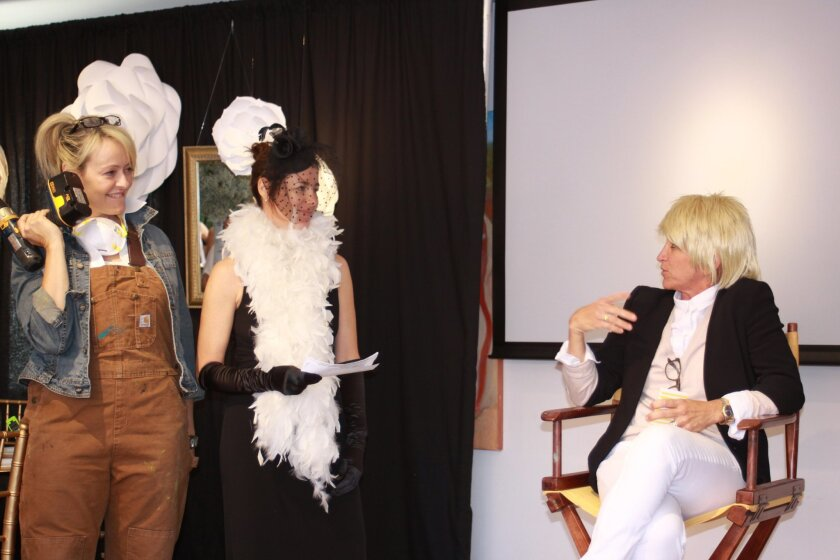 """In Las Patronas tradition, a skit is staged to spin the latest Jewel Ball theme. In this case, the """"Ellen Las Patronas Show"""" presents a design competition to find the 2015 Jewel Ball decorator. """"Ellen"""" (sherrie Black) interviews Kathryn Munoz, Carolyn Brann and Kathryn Gayner for their ideas."""