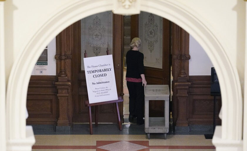 """A """"temporarily closed"""" sign stands outside doors."""