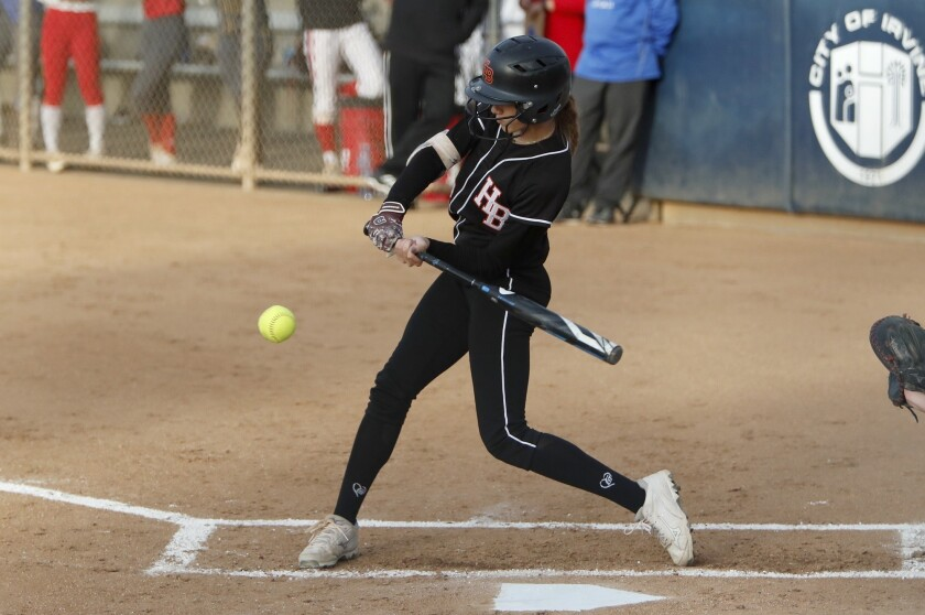 Huntington Beach High's Jadelyn Allchin bats for the Green team during the first inning in the Orang