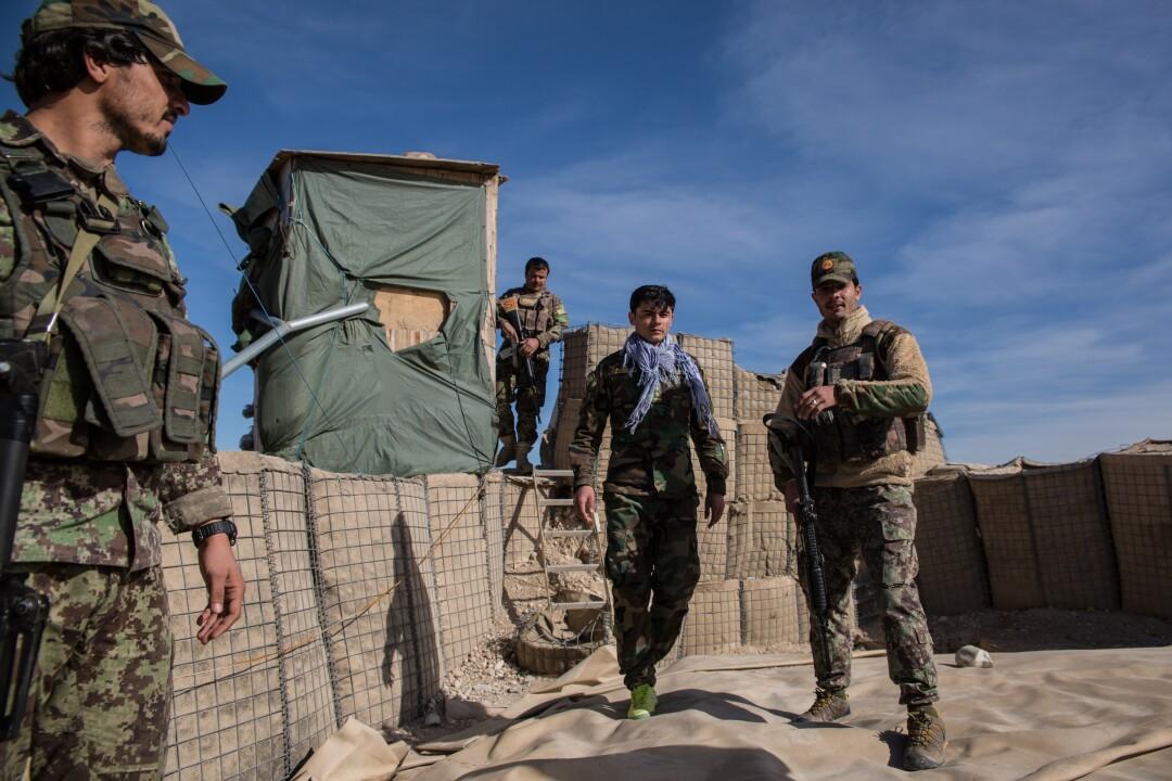 Soldiers man their hilltop outpost in the Tarnak Wa Jaldak district.