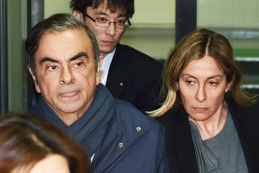 Former Nissan Chairman Carlos Ghosn and his wife Carole leave a lawyer's office in Tokyo on April 3.