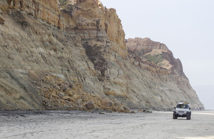 Local officials are warning people of the dangers of relaxing on the beach underneath unstable cliffs. At Torrey Pines State Beach in San Diego debris from a recent cliff collapse could be seen on Thursday, Aug. 8, 2019.