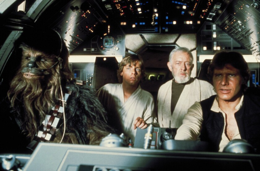 """Peter Mayhew, Mark Hamill, Alec Guinness and Harrison Ford in 1977's """"Star Wars."""""""