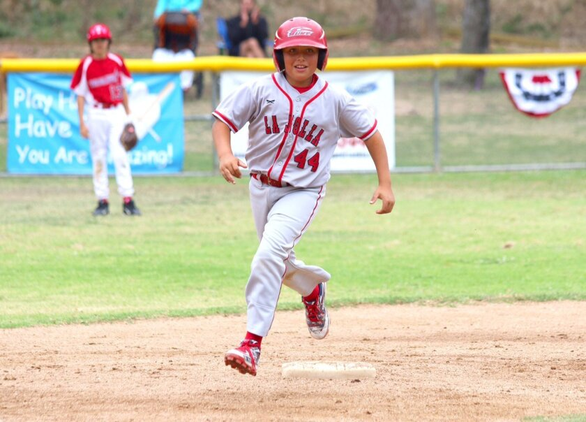La Jolla Youth Baseball's Jacob Campagna rounds the bases after hitting a home run.