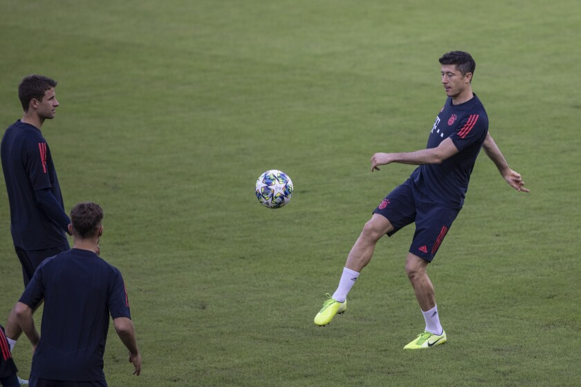 Bayern's Robert Lewandowski warms up during a training session at Georgios Karaiskakis Stadium in the port of Piraeus, near Athens.