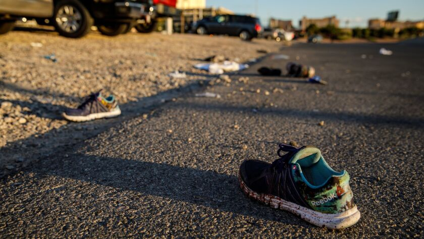 After the mass shooting in Las Vegas, personal items lie at the scene. Participants at a South L.A. rally are being encouraged to bring shoes belonging to or representing victims of gun violence.