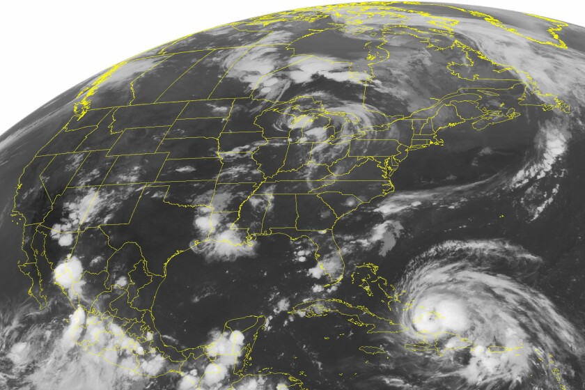 "A satellite image of Hurricane Irene, lower right, a Category 2 storm from 2011 that featured winds up to 100 mph which set off what scientists call ""stormquakes"" on the seafloor."