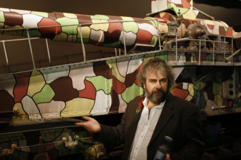 Director Peter Jackson points out a multi-colored cannon used during the early days of the World War I at the museum exhibition he has created on Friday, April 17, 2015, in Wellington, New Zealand. Jackson hopes Great War Exhibition will give people new insight into World War I. (AP Photo/Nick Perr