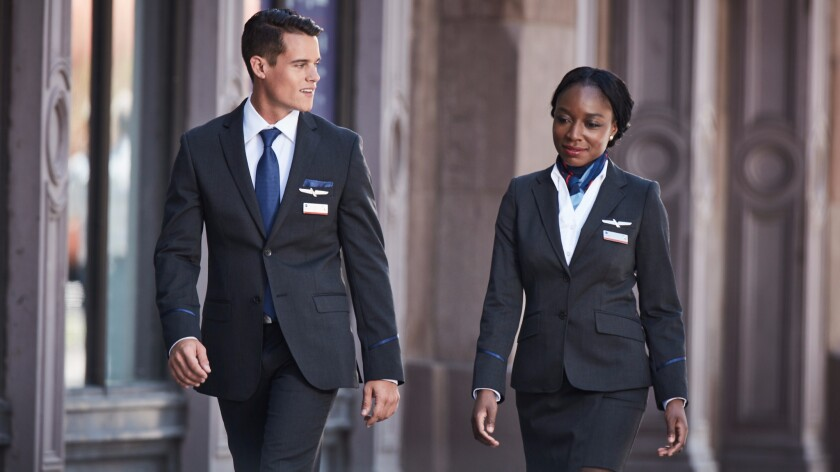 American Airlines says that only 14 employees have reported problems with new uniforms, which rolled out in September. The union representing the flight attendants for American Airlines, however, says 600 have complained.