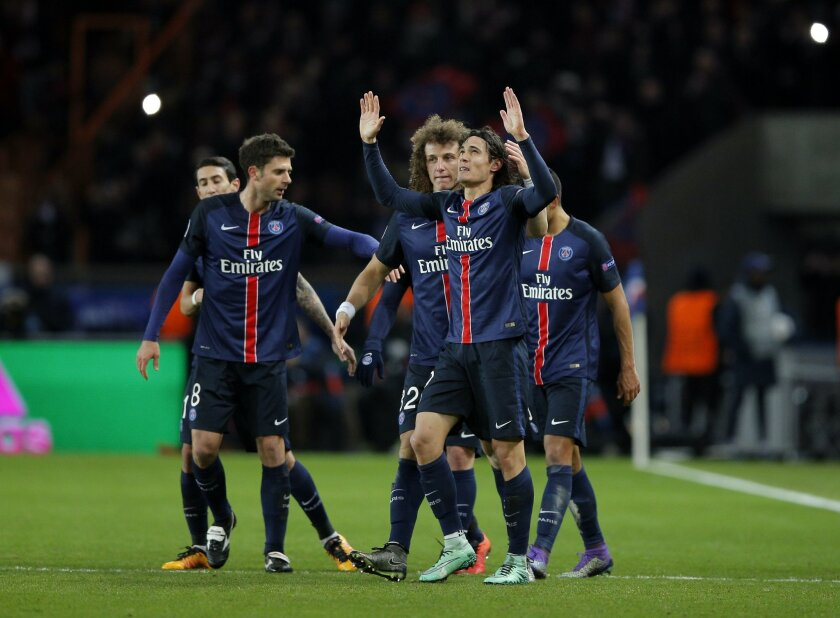PSG's Edinson Cavani celebrates his goal with teammates during the Champions League round of 16, 1st leg soccer match between Paris Saint Germain and Chelsea at the Parc des Princes stadium in Paris, France, Tuesday, Feb. 16, 2016. (AP Photo/Christophe Ena)