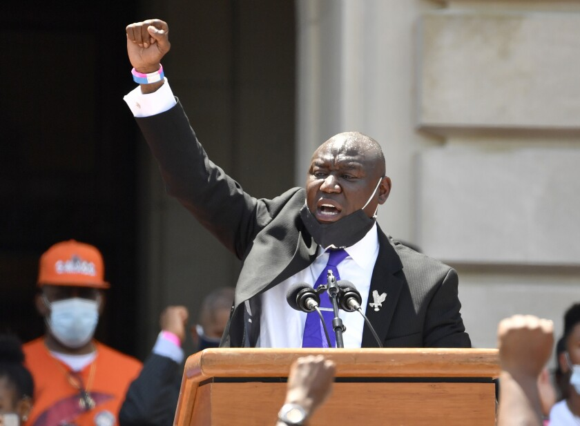 """FILE - In this June 25, 2020 file photo Attorney Benjamin Crump speaks to a gathering on the steps at the Kentucky State Capitol in Frankfort, Ky. Crump is representing the family of a Black man who was shot and killed Los Angeles County sheriff's deputies after he was stopped for a traffic violation while riding a bicycle and later """"made a motion"""" toward a gun on the ground. (AP Photo/Timothy D. Easley, file)"""
