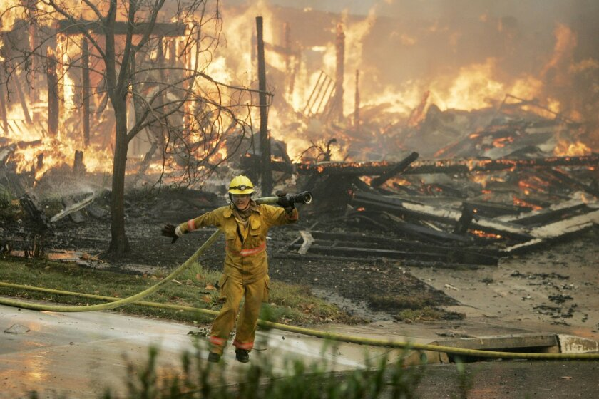 The Witch Creek/Guejito fire burned into Rancho Bernardo early in the morning of Oct. 22, 2007
