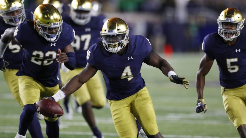 Notre Dame linebacker Te'von Coney (4) reacts after intercepting a Stanford pass during the second half on Saturday in South Bend, Ind.
