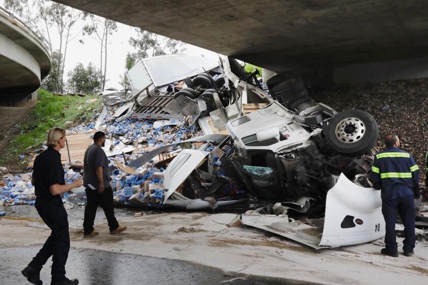 Cleanup is underway after a big-rig crash Thursday morning left hundreds of cans of Modelo Especial beer scattered across and under a 10 Freeway overpass.