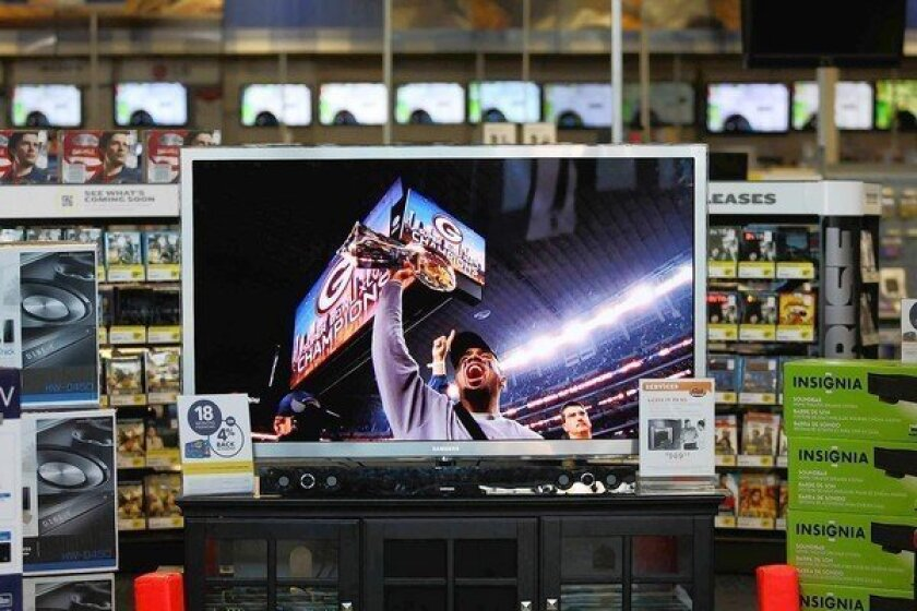 A 65-inch Samsung TV at Best Buy in Burbank shows the Green Bay Packers' Super Bowl win in 2011.