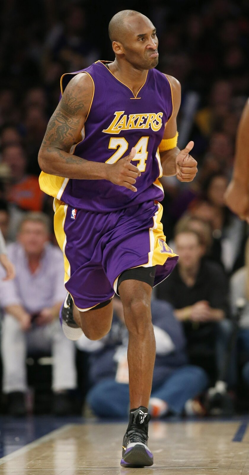 Los Angeles Lakers forward Kobe Bryant runs down court after scoring in the second half of an NBA basketball game against the New York Knicks at Madison Square Garden in New York, Sunday, Nov. 8, 2015. The Knicks won 99-95. (AP Photo/Kathy Willens)