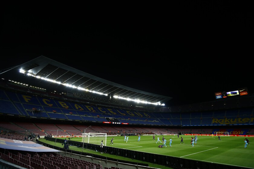 FC Barcelona and Leganes players during the Spanish La Liga soccer match between FC Barcelona and Leganes at the Camp Nou stadium in Barcelona, Spain, Tuesday, June 16, 2020. (AP Photo/Joan Montfort)