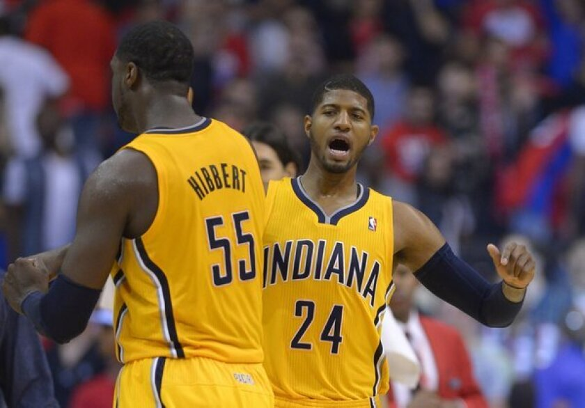 Pacers guard Paul George and center Roy Hibbert celebrate in the closing seconds of their victory over the Clippers at Staples Center.