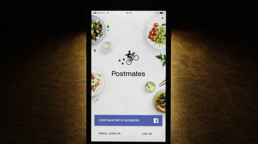 This Tuesday, Feb. 20, 2018, photo shows the Postmates app on an iPhone in Chicago. More fast-food c