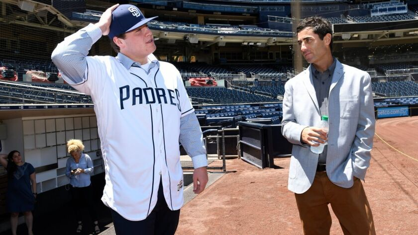 SAN DIEGO, CA - JULY 2: Ryan Weathers, the 2018 number one draft pick, of the San Diego Padres visits with AJ Preller and is introduced to media and poses for photos at PETCO Park on July 2, 2018 in San Diego, California. (Photo by Andy Hayt) *** Local Caption *** Ryan Weathers;AJ Preller