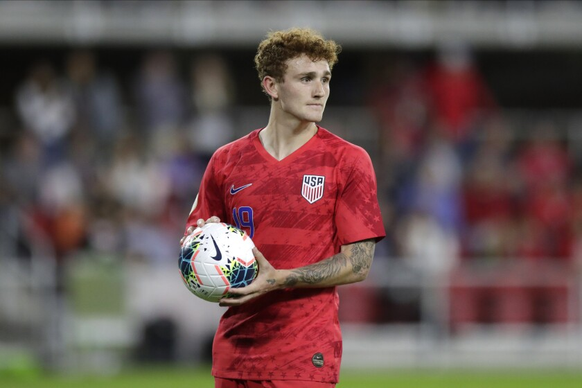 United States' Josh Sargent holds a ball during the second half of a CONCACAF Nations League soccer game against Cuba.