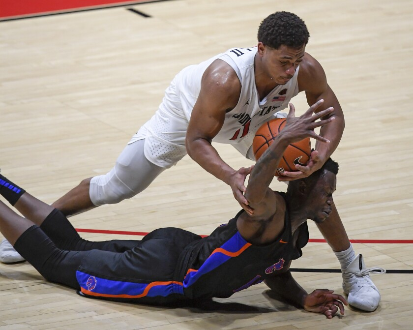 SDSU senior Matt Mitchell battles with Boise State's Emmanuel Akot for a loose ball in Thursday's 78-66 win.