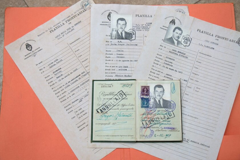 Mengele's Italian passport, issued to him under the false name Gregor Hellmuth, can be seen with several Argentine police documents owned by Solana Beach military artifacts expert Craig Gottlieb.