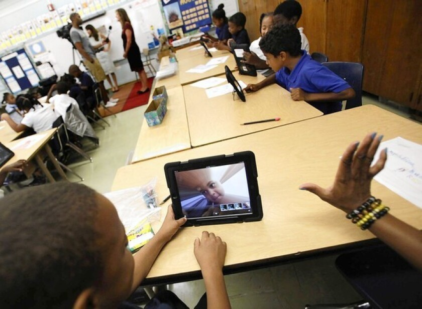 A student at Broadacres Elementary School in Carson, part of the Los Angeles Unified School District, experiments with his district-provided iPad's camera.