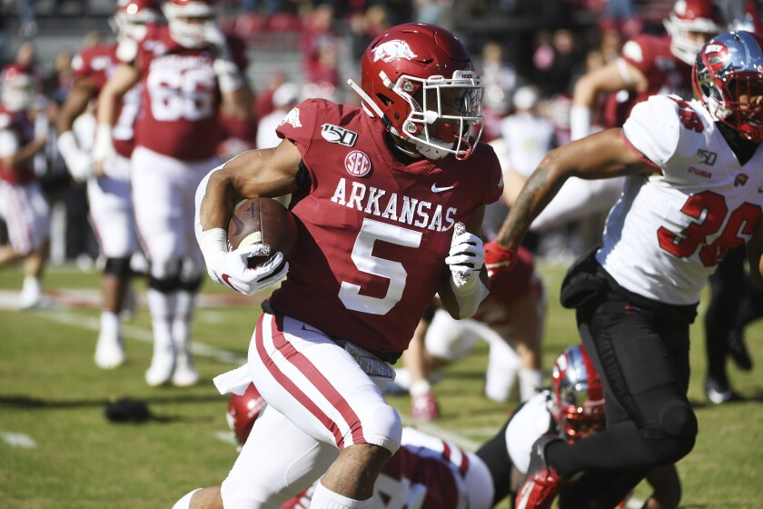 FILE - In this Nov. 9, 2019, file photo, Arkansas running back Rakeem Boyd (5) runs the ball against Western Kentucky during the second half of an NCAA college football game in Fayetteville, Ark. Boyd ran for 1,133 yards and eight scores as a junior last season while rushing for more than 100 yards in five games. (AP Photo/Michael Woods)