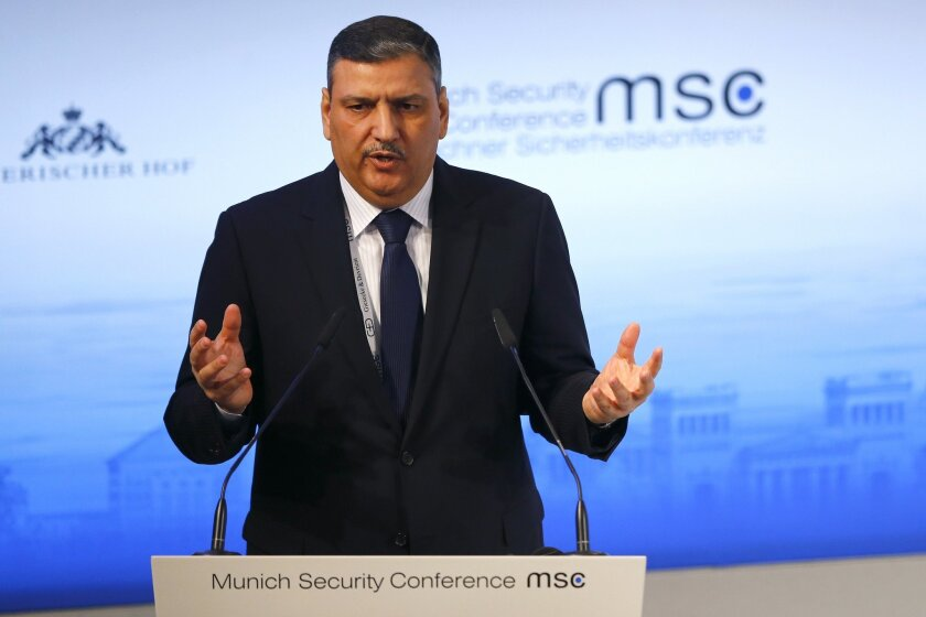 Former Prime Minister of Syria, Riad Hijab, gestures during his speech at the Security Conference in Munich, Germany, Sunday, Feb. 14, 2016. (AP Photo/Matthias Schrader)
