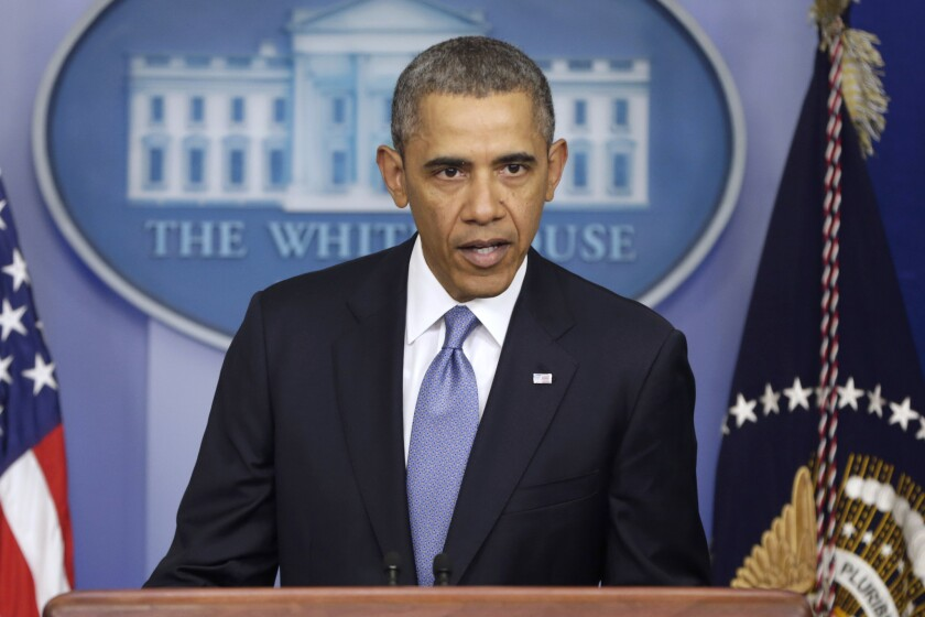 President Obama imposed sanctions against Russian officials, including advisers to President Vladimir Putin, for their support of Crimea's vote to secede from Ukraine.