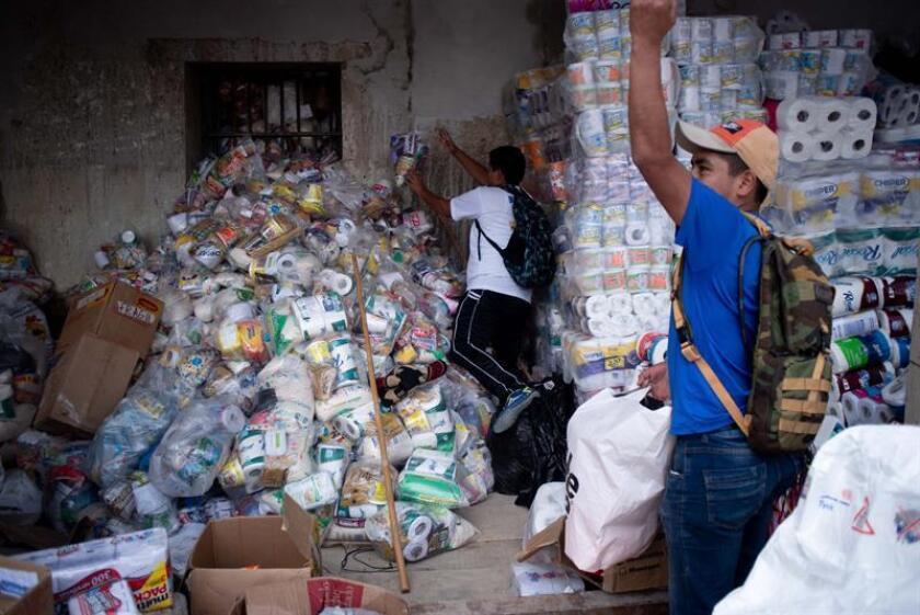 En la imagen, un centro de acopio de ayuda para víctimas del volcán de Fuego en Guatemala. EFE/Archivo
