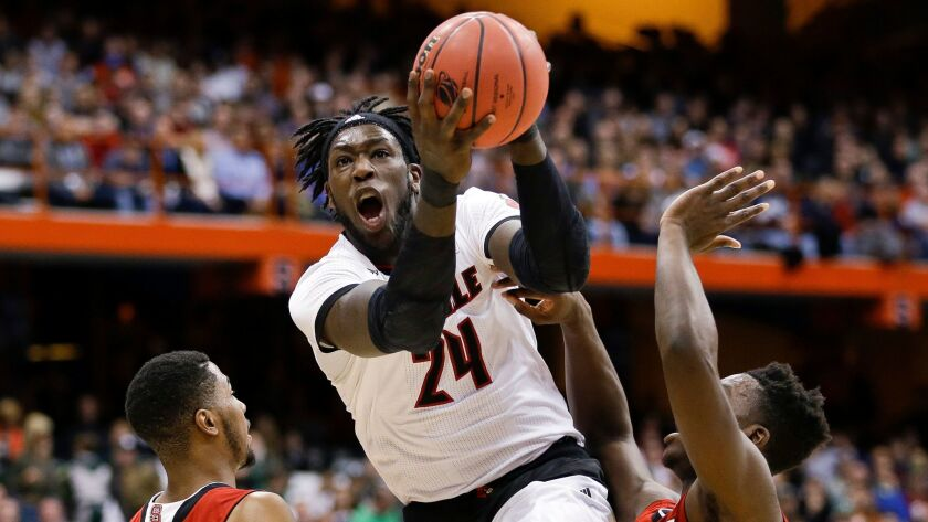 As a collegian at Louisville, Montrezl Harrell puts up a shot in an NCAA tournament game against Nor