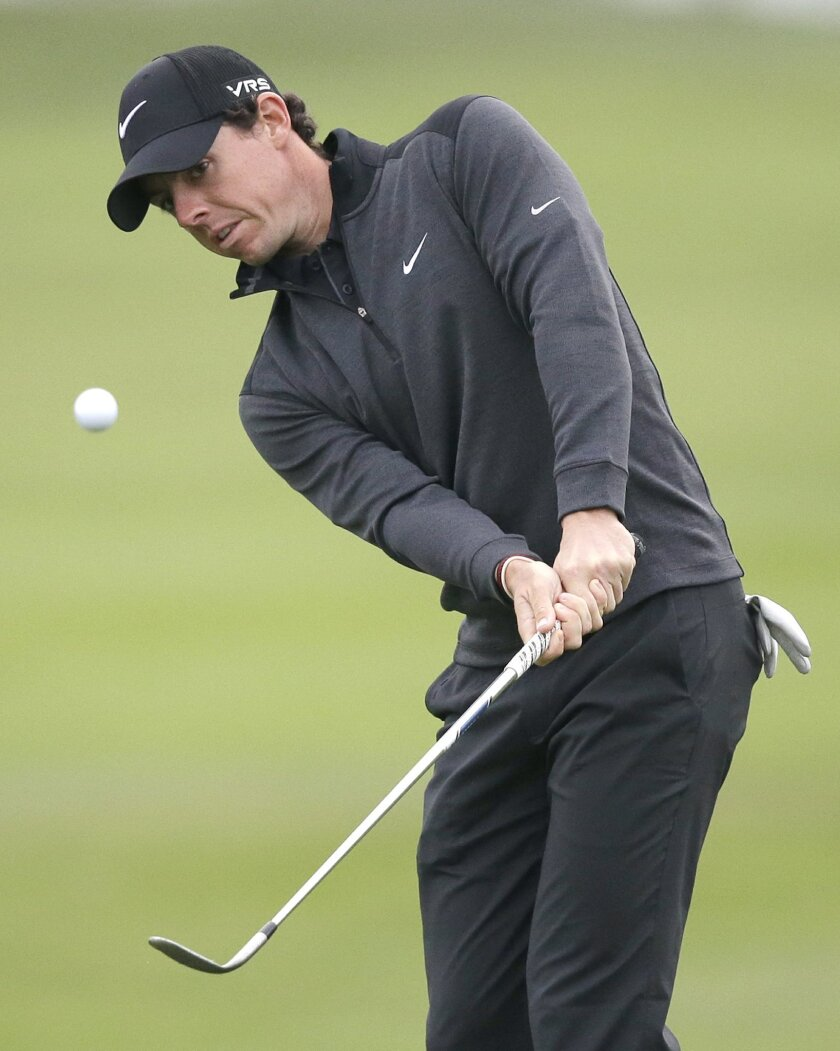 Golfer Rory McIlroy of Northern Ireland chips onto the 10th green during the second round of the Honda Classic golf tournament, Friday, Feb. 28, 2014 in Palm Beach Gardens, Fla. (AP Photo/Wilfredo Lee)