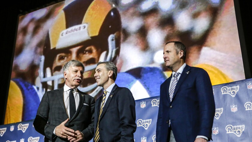 Rams owner Stan Kroenke, left, is joined by chief executive Kevin Demoff, center, and Chris Meany of Hollywood Park Land Co. after the news conference to formally announce the team's return to L.A.