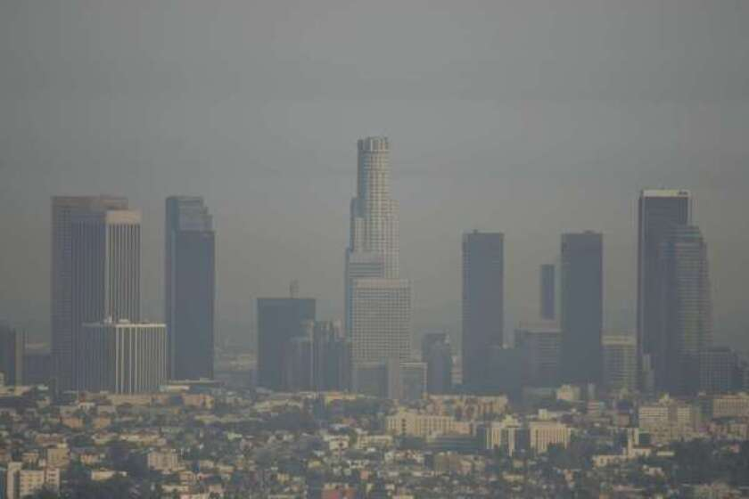 Smoggy days like this one -- Nov. 8, 2005 -- are less frequent today in Los Angeles, even though there are many more cars on the road, according to new research. Scientists credit California's strict emissions standards.