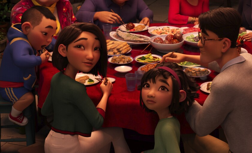 "This image released by Netflix shows animated characters, from left, Chin, voiced by Robert G. Chiu, Mrs. Zhong, voiced by Sandra Oh, Fei Fei, voiced by Cathy Ang and Father, voiced by John Cho in a scene from ""Over the Moon."" (Netflix via AP)"