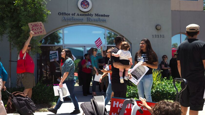 People rally in favor of single-payer healthcare in California outside Assembly Speaker Anthony Rend