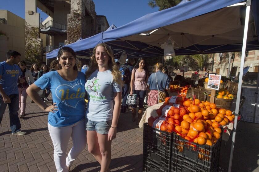 UCLA seniors Jasneet Bains, left, and Joanna Wheaton manage the market on the campus.