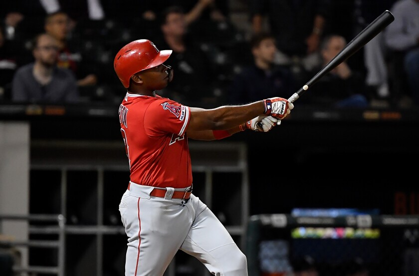 Angels' Justin Upton hits a home run in the ninth inning against the Chicago White Sox on Sept. 6.
