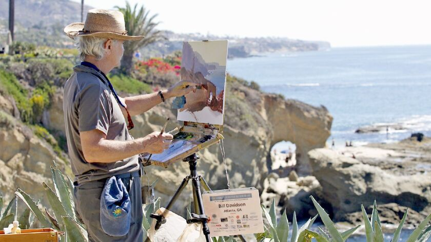 Artist Bill Davidson sets his easel on a lookout where he paints the arch and coves where he partici