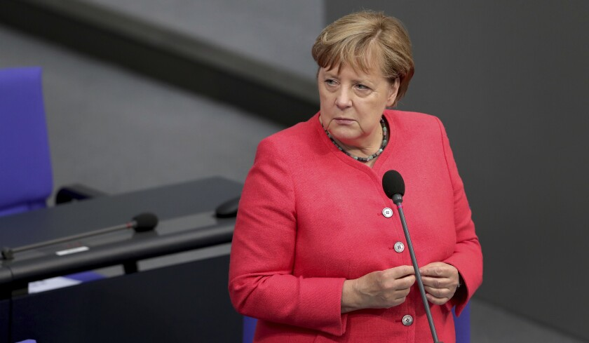 German Chancellor Angela Merkel takes questions of a lawmaker of the far right party 'Alternative fuer Deutschland' (Alternative for Germany) during a meeting of the German federal parliament, Bundestag, at the Reichstag building in Berlin, Germany, Wednesday, July 1, 2020. (AP Photo/Michael Sohn)