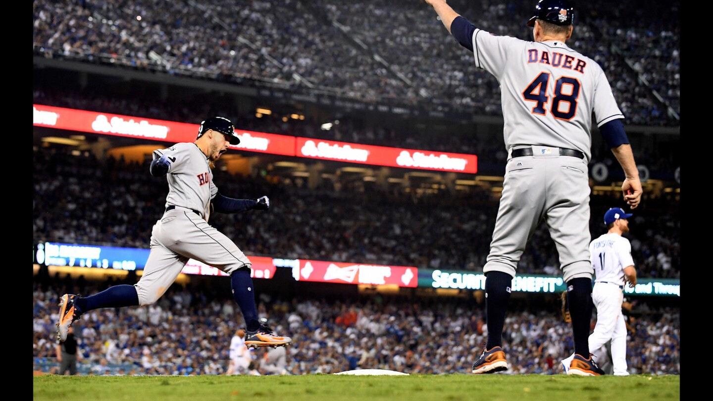 Astros center fielder George Springer celebrates his two-run home run against the Dodgers in the 11th inning of Game 2.